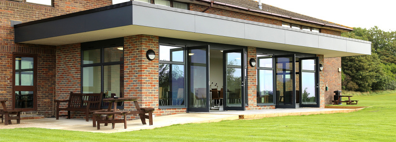 Exterior view of the stylish and modern extension to Hollingbury Golf Club in Brighton, East Sussex