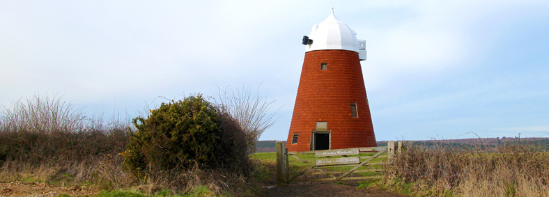 Exterior view of Halnaker Windmill, a sympathetically and traditionally refurbished heritage building in Chichester, West Sussex