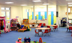 Interior view of the newly built Friary Pre-School in Crawley, West Sussex, showing the bright learning space and colourful interior.